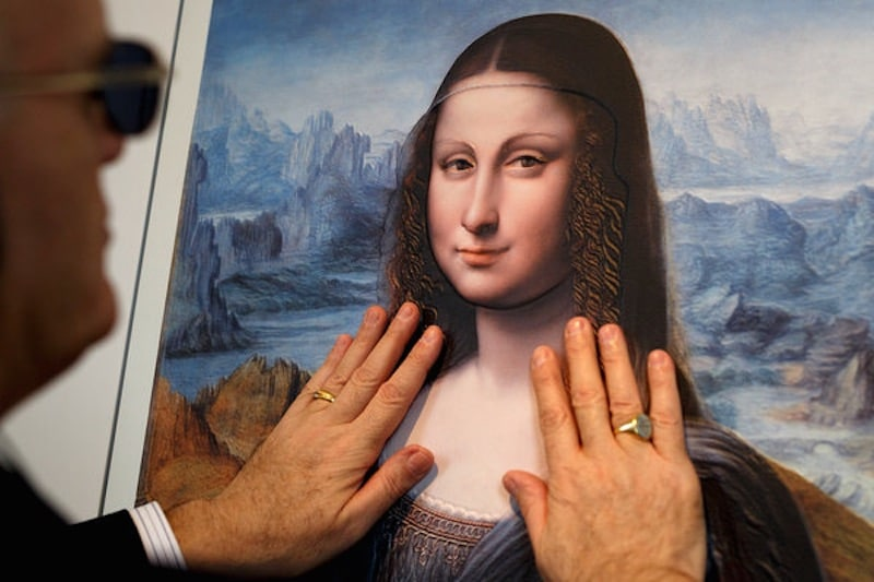 """A visitor at Madrid's Museo del Prado examines a three-dimensional version of a painting in the museum's collection. The painting is a copy of the """"Mona Lisa"""" made by a pupil of Leonardo da Vinci. Credit Pablo Blazquez Dominguez/Getty Images"""