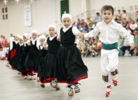 FILE - In this Saturday July 31, 2010 photo, John Lejardi, 6, right, and Tea Uranga, lead fellow dancers from the Basque dance group Herribatza Danzariak in Boise, Idaho. One of the largest Basque communities in the United States will spend the next five days celebrating the traditional Jaialdi festival in southwestern Idaho. An estimated 35,000 to 50,000 people are expected to attend the event. (AP Photo/Idaho Statesman, Darin Oswald, File) MANDATORY CREDIT