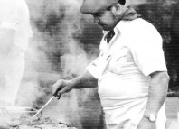 Mario Zubiria tends to his grill at the Pendleton Round-Up where he has fed the rodeo crowd since 1984. Zubiria died on Friday.
