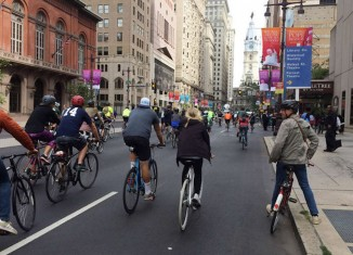 Broad Street was traffic-free on Saturday. People stuck to sidewalks at first, but soon made the streets their own. INGA SAFFRON / Staff