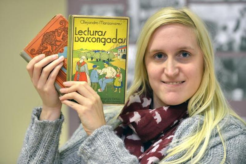 HISTORY: Charlotte Hall from the Bradford's Peace Museum holding with some of the books used to help maintain children's links with their home country