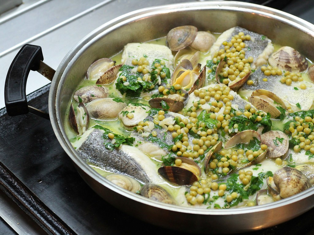 Merluza a la Koxkera: hake with peas, clams, garlic, white wine, and parsley. For members only. Photo by Craig Cavallo